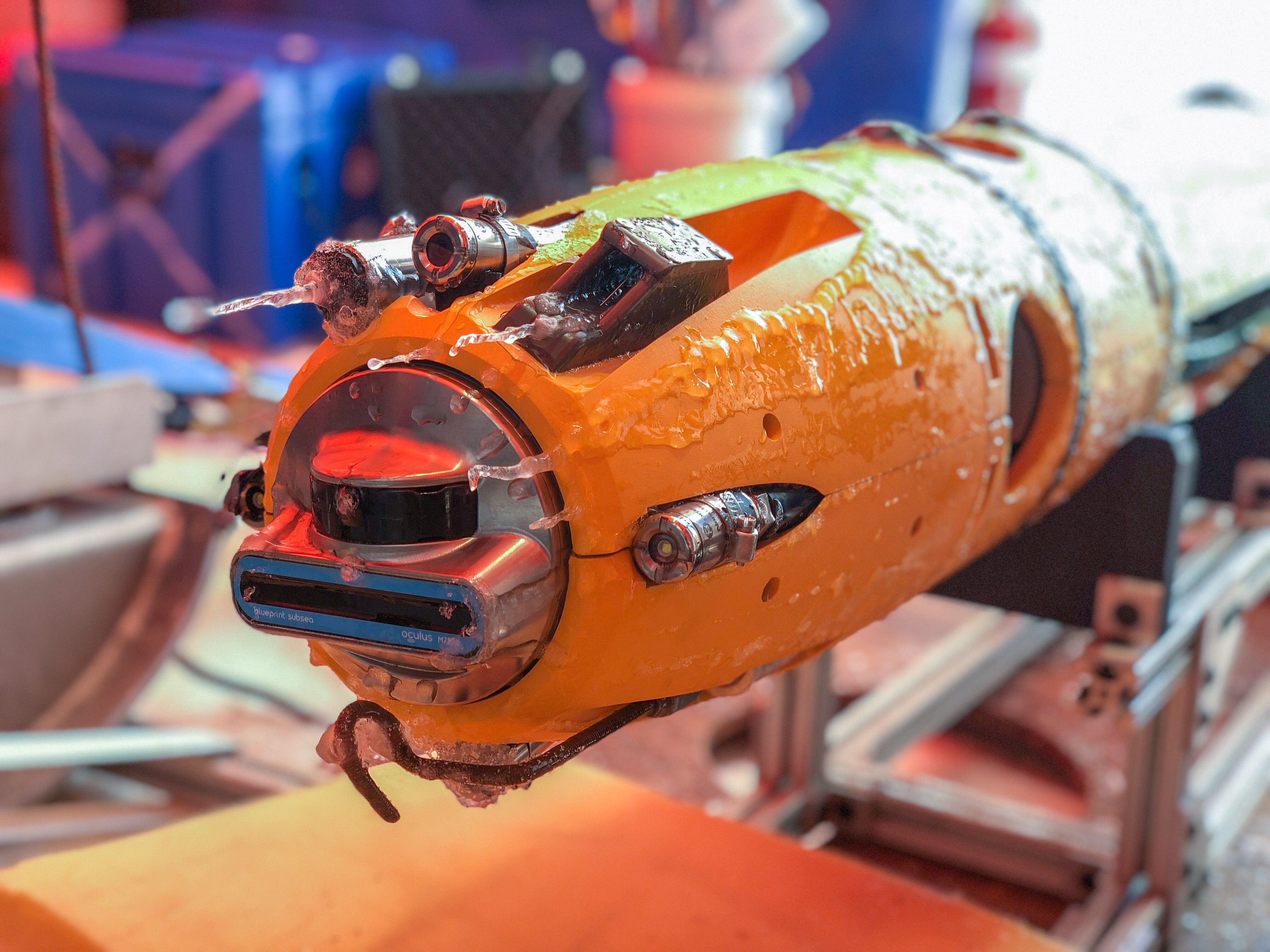 "Credit: Georgia Tech / Britney Schmidt  ""Robotsicle,"" researcher Britney Schmidt's nickname for this photo. Icefin's ""face"" with instruments and cameras covered in ice after a research dive on a separate project. Icefin is prepping for a future trip to Jupiter's moon Europa to sea for life in its vast ocean."