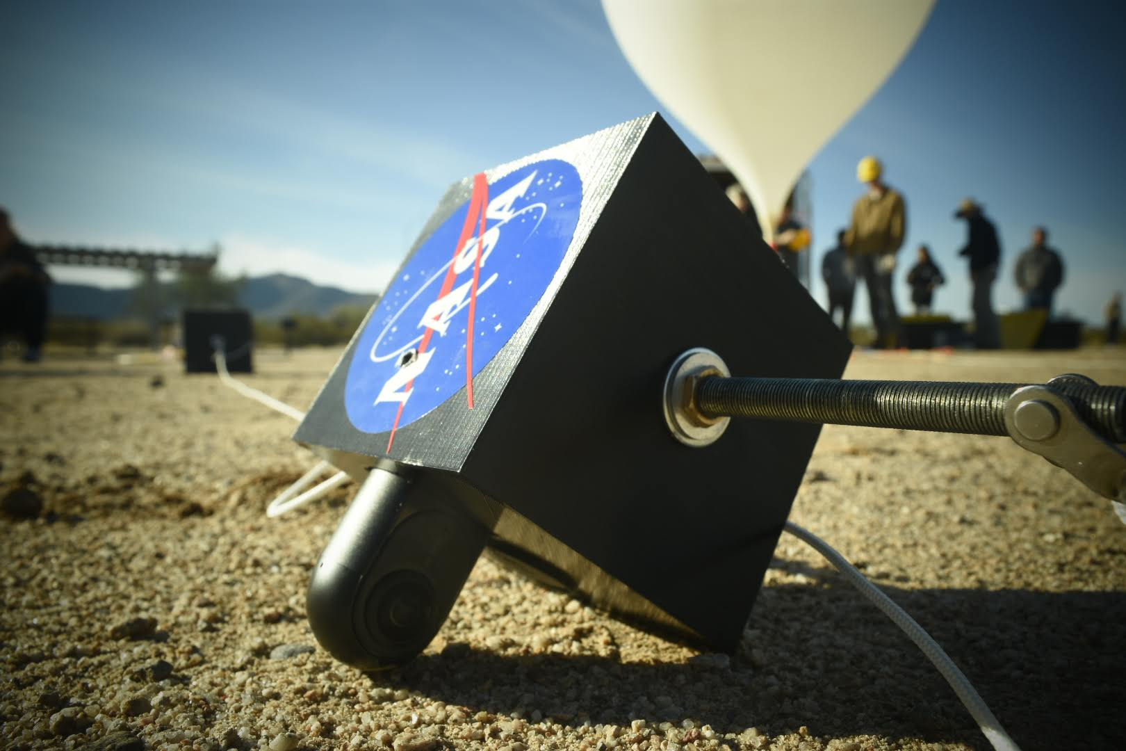 UA SEDS payload with NASA sticker. Background is helium balloon being inflated.