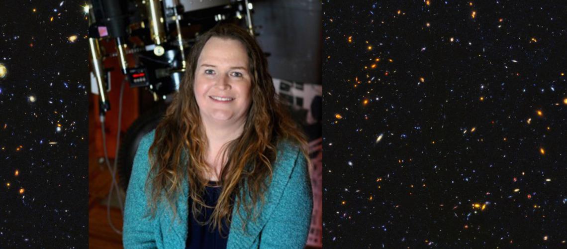"Adams alongside the 122-year-old 24"" Alvin Clark telescope at Lowell Observatory"