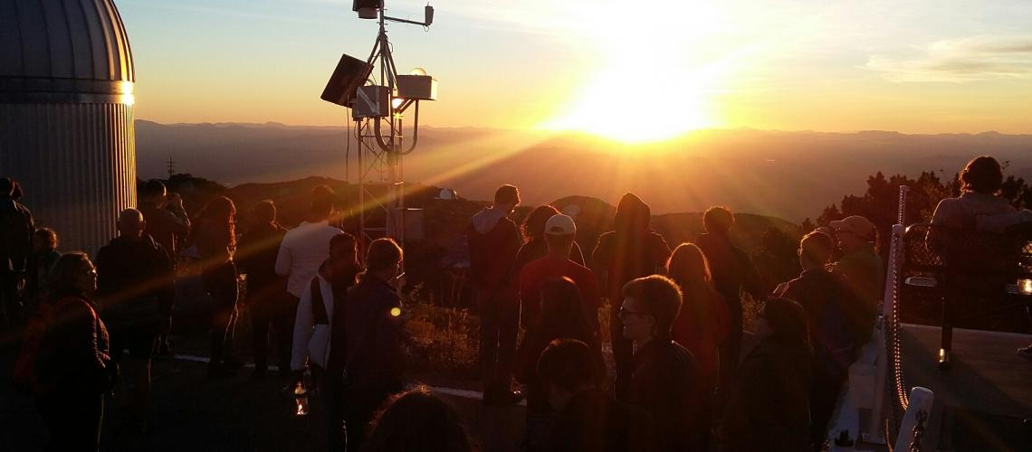 A large group of UA Space Grant Interns, SEDS and Astronomy Club members watch sunset at Kitt Peak Observatory.