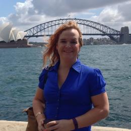 Portrait of Danielle Adams with bridge to Sydney Opera House.