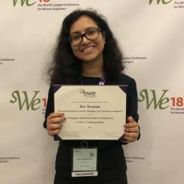 Ava Karanjia poses with her first-place award for the undergraduate collegiate technical poster competition at the Society of Women Engineers Conference.