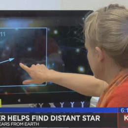 Brenda Fry points out the location of newly discovered star on a computer screen.