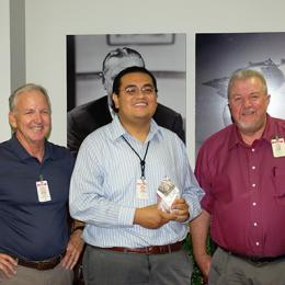 Luis Tapia holds Society of Hispanic Professional Engineers STAR Innovator Award, with two Honeywell employees
