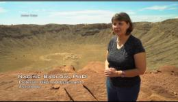 Nadine Barlow stands on the edge of Meteor Crater, AZ.