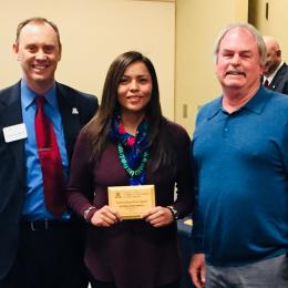Rayanna Benally holds SNRE's Fall 2017 Outstanding Graduating Senior Award, with her mentor Steven Archer,  and Shane Burgess - Dean of College of Agriculture and Life Sciences